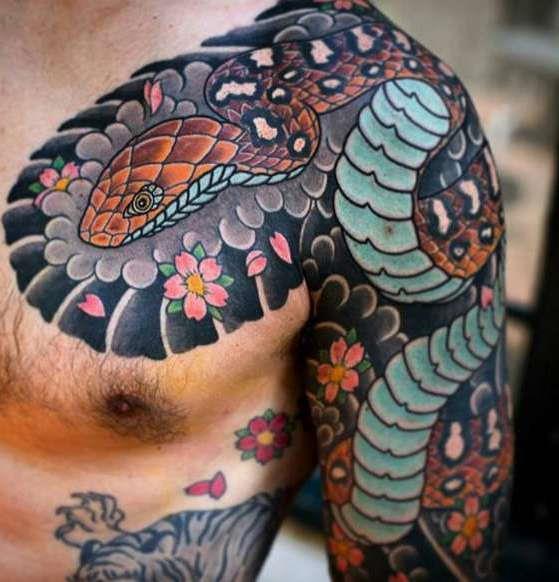 Татуировка змея в японском стиле на груди и плече