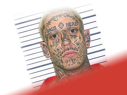 Заключенный с тату на лице