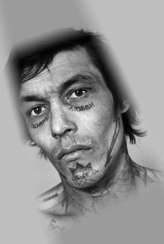 Татуировка у заключенного на лице