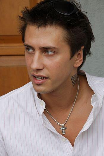 Павел прилучный фото его тату на шей