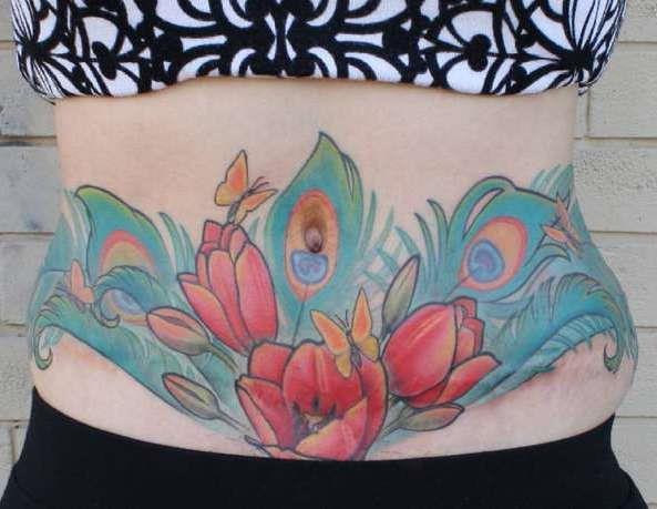 Цветная татуировка на шраме