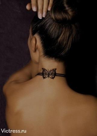 тату на шее в виде бабочки