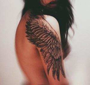 UgyIAJnI0M 300x283 Модные татуировки для девушек 2014