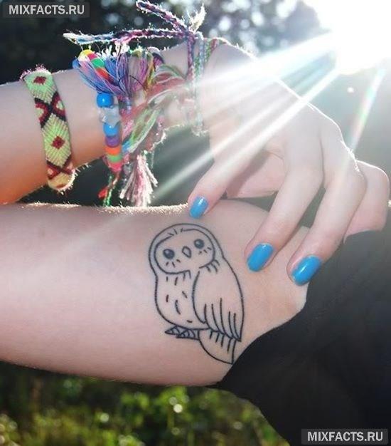 татуировки на бицепсе в виде совы