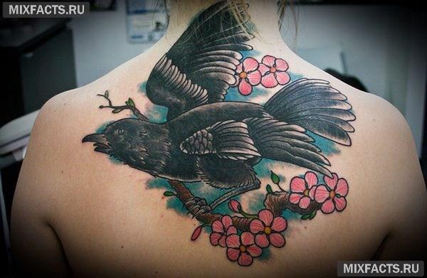 татуировки для девушек на спине и их значение