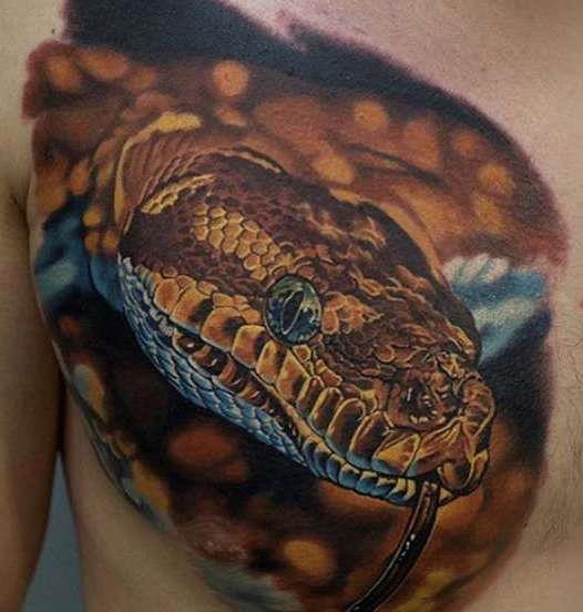 Татуировка змея на груди в стиле реализм