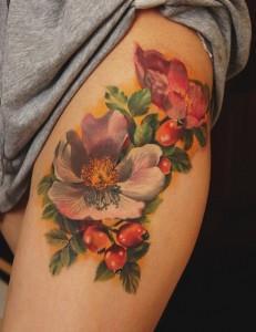 E1APXbn9rF81 231x300 Модные татуировки для девушек 2014