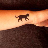 что означает тату кошка