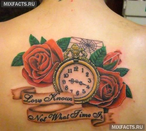 татуировка роза со словами на спине